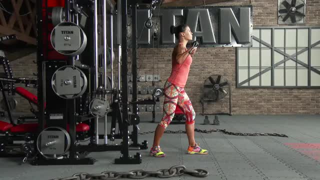 Female Cable Standing Incline Chest Press demonstration