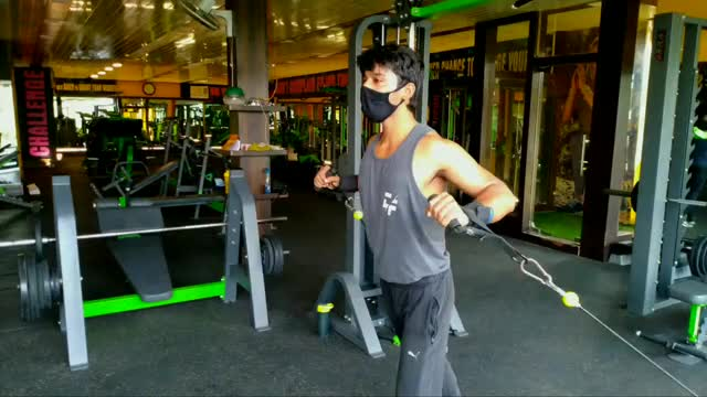 Male Cable Standing Incline Chest Press demonstration
