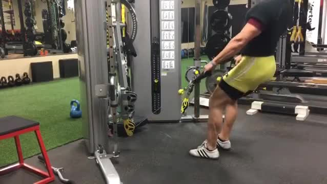 Male Cable Squat demonstration