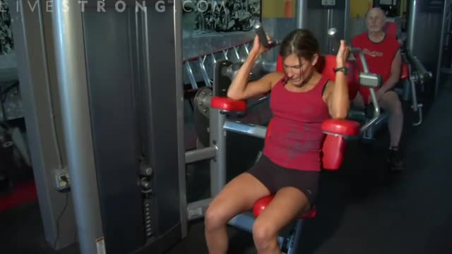 Female Lever Seated Crunch Demonstration