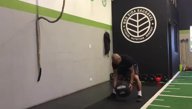 Male Medicine Ball Alternating Side Rotation Throw (against wall) demonstration