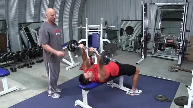 Male EZ Bar Back Of The Head Lying Tricep Extension demonstration