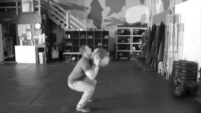 Male Medicine Ball Squat and Overhead Throw demonstration