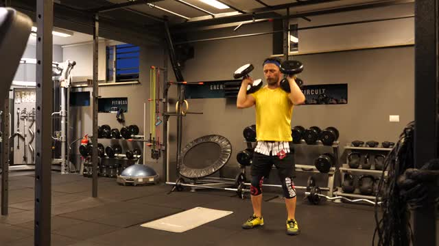 Male Dumbbell Hang Clean demonstration