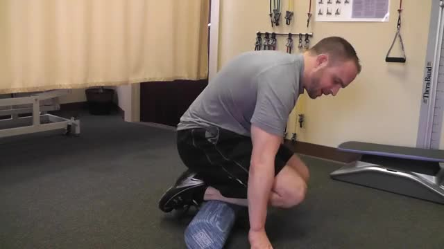 Male Anterior Calf Foam Rolling demonstration