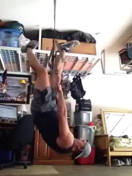 Male Suspension Inverted Shrug demonstration