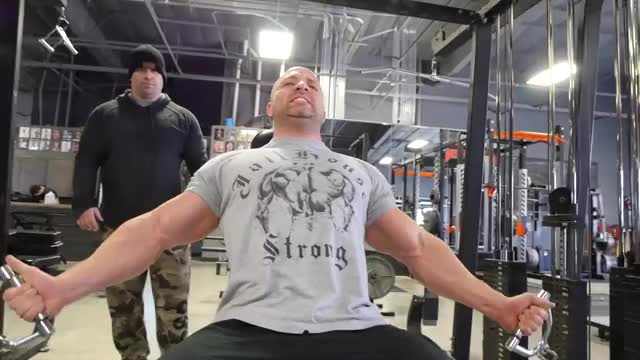Male Two Arm Cable Curl On Incline Bench demonstration