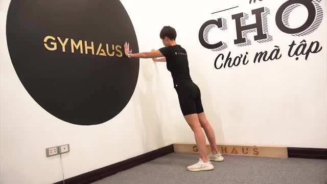 Female Wall Push Up demonstration