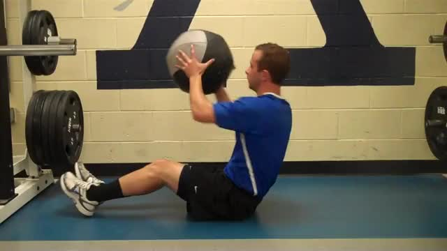 Male Medicine Ball Russian Twist Throw (against wall) demonstration