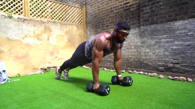 Push-up on the 2 Dumbbells flat on the floor (Elbows in) demonstration