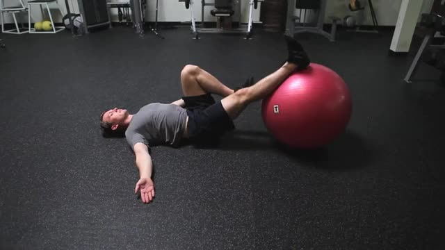 Single-Leg Swiss Ball Hip Raise and Leg Curl demonstration