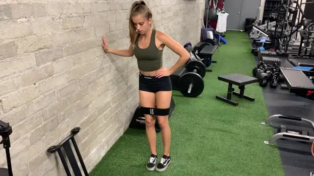 Female Standing External Rotation with Resistance Band demonstration