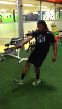 Male Cable Single Leg Squat and Row demonstration