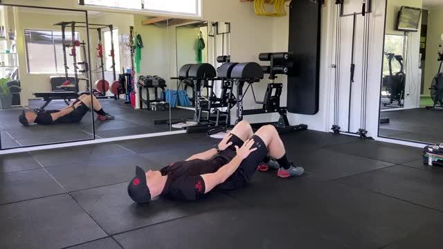 Knee Slide Crunch demonstration