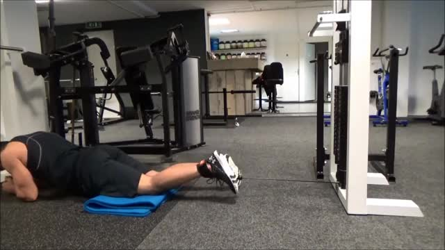 Male One Leg Lying Cable Hamstring Curl demonstration