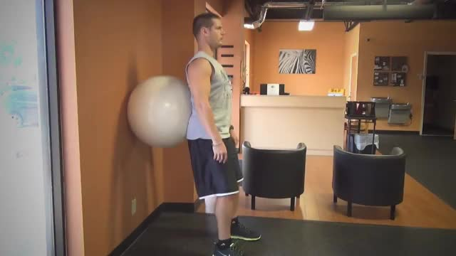 Male Exercise Ball Wall Squat demonstration
