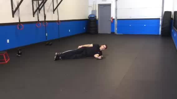 Male Dumbbell Shoulder Internal Rotation (on floor) demonstration