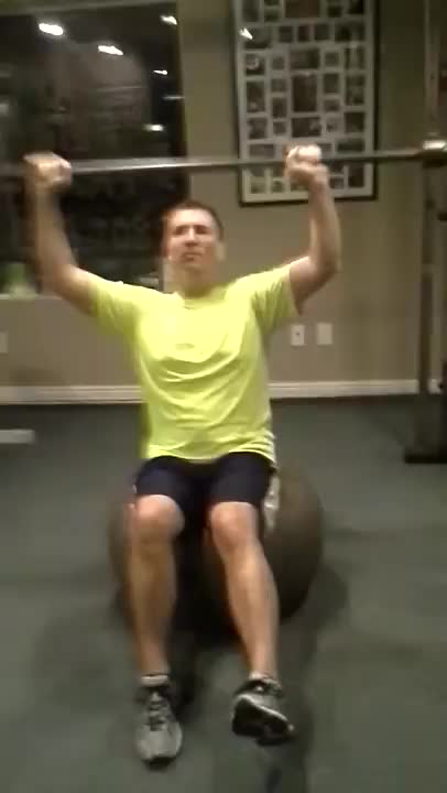 Male Exercise Ball Barbell Press demonstration