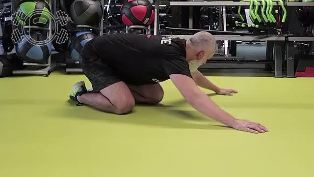 Male Floor Lat Stretch demonstration
