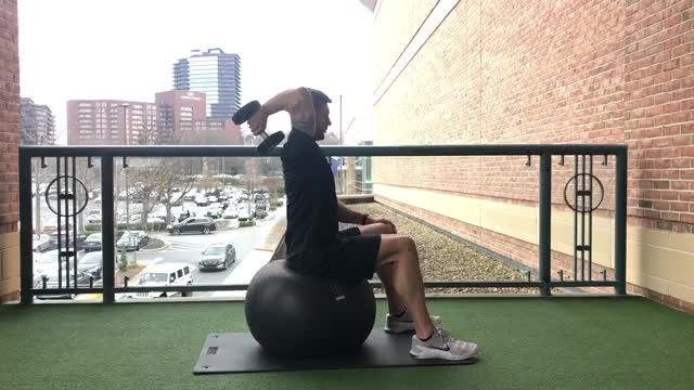 Male Exercise Ball One Arm Dumbbell Extension demonstration