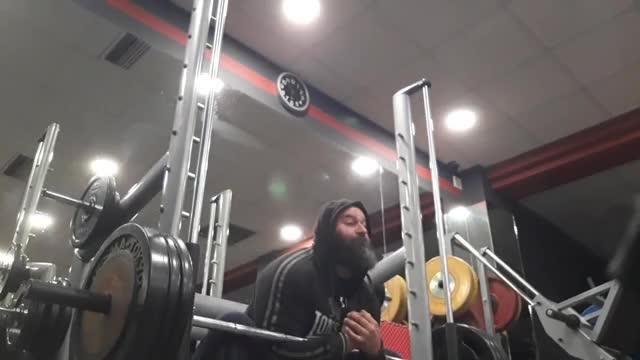 Male Smith Machine Zercher Squat demonstration