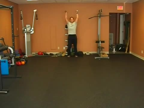 Male Walking Lunge With Overhead Weight Demonstration