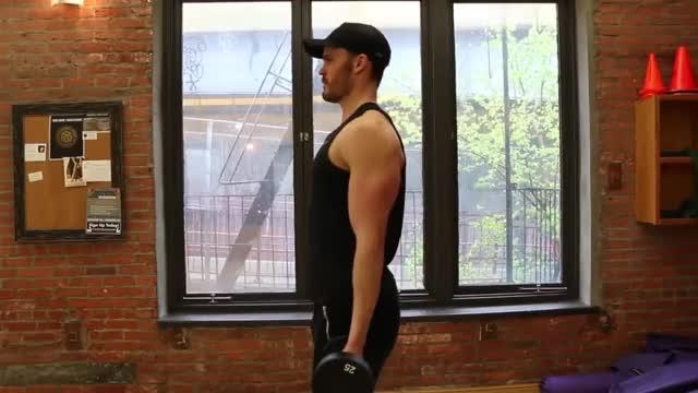 Male Standing Dumbbell Drag Curl demonstration