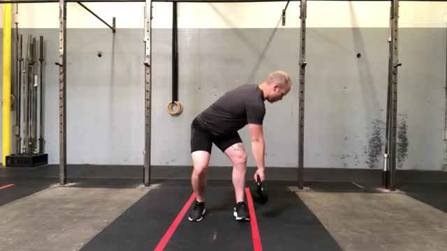 Kettlebell Rotational Clean to Twist Press demonstration