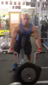 Male T-Bar Machine Shrug demonstration