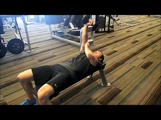 Male One Arm Lying Dumbbell Extension demonstration