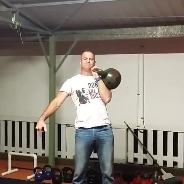 Standing One-Arm Kettlebell Military Press To The Side demonstration
