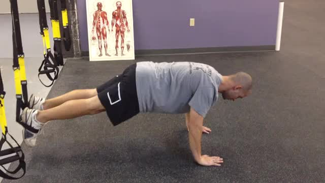 Male Feet-Elevated TRX Push-Up demonstration