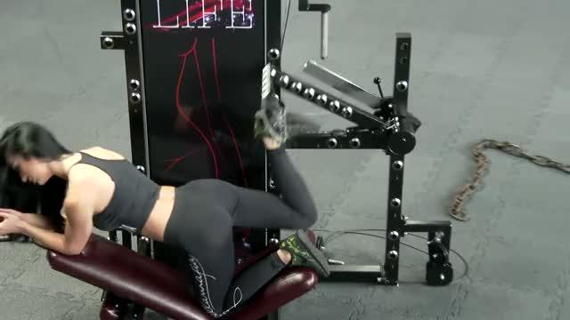 Female Lever Kneeling Rear Kick demonstration