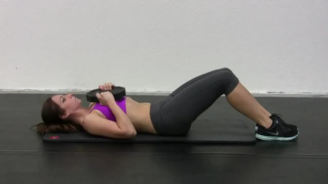 Female Weighted Crunch (plate on chest) demonstration
