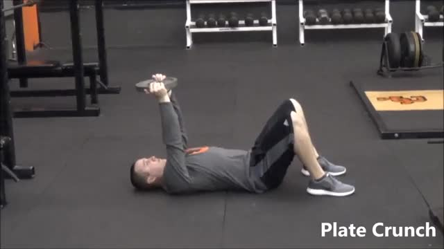 Male Weighted Crunch (plate on chest) demonstration