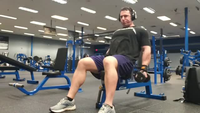 Male One Arm Dumbbell Front Raise On Incline Bench demonstration