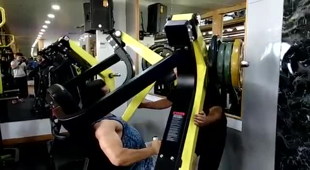 Male Lever Wide Grip Chest Press (plate loaded) demonstration
