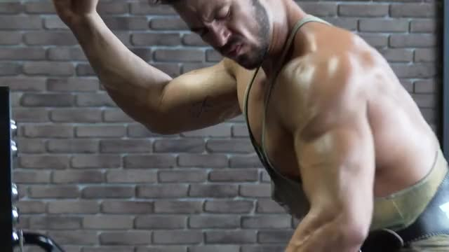 Lever Extended Arm Kneeling Lateral Raise demonstration