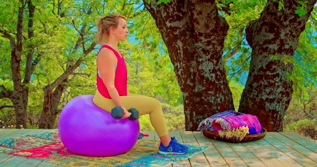 Female Exercise Ball Dumbbell Curl demonstration