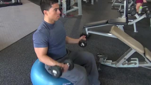 Male Exercise Ball Dumbbell Curl demonstration