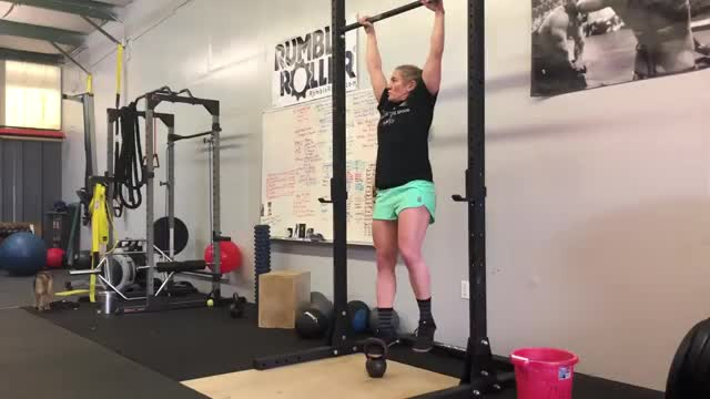 Female Weighted Pull Up Hang demonstration