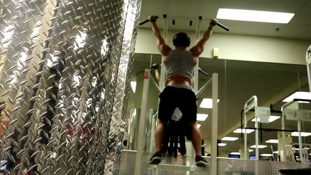 Male Weighted Pull Up Hang demonstration