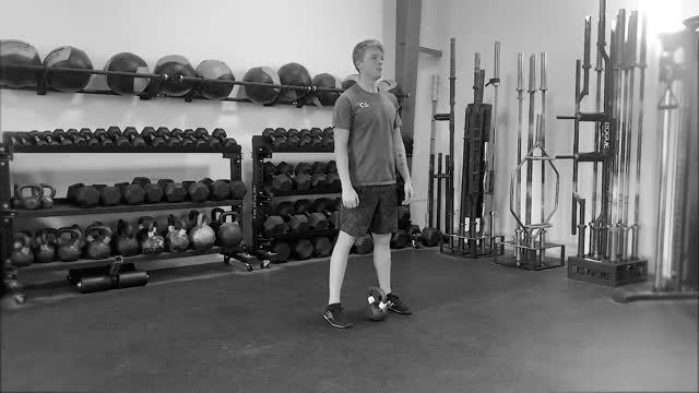 Single Arm Kettlebell Clean to Cossack Squat demonstration