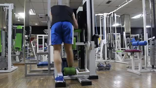 Lever Standing Leg Curl demonstration