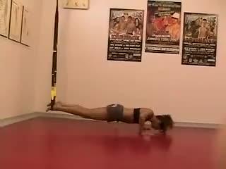 Female Suspension Atomic Push-Ups demonstration
