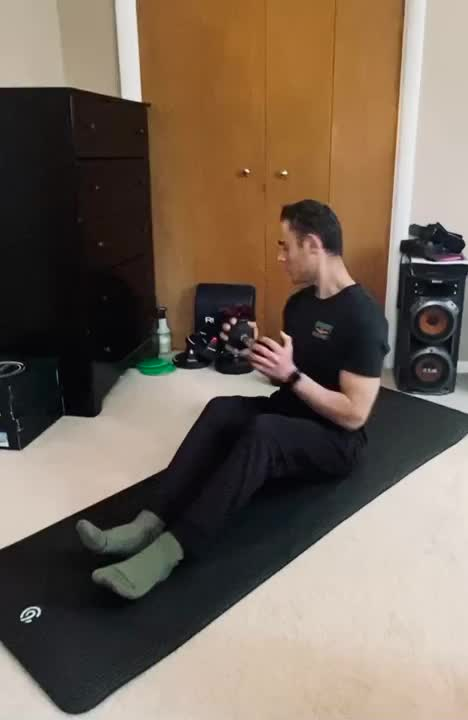Dumbbell Russian Twist with Overhead Press demonstration