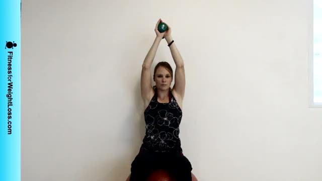 Female Exercise Ball Two Arm Dumbbell Extension demonstration