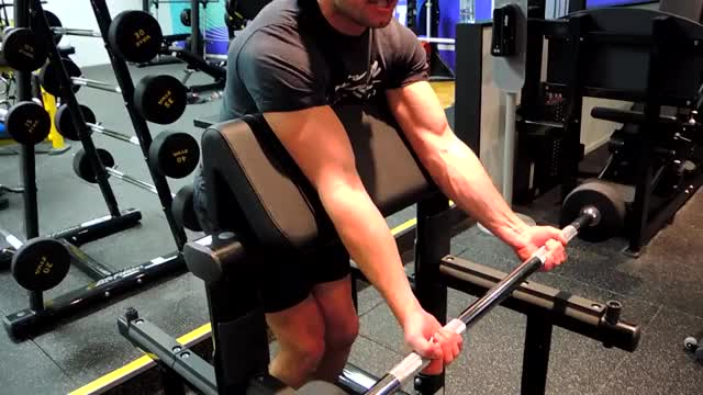 Male Barbell Standing Preacher Curl demonstration