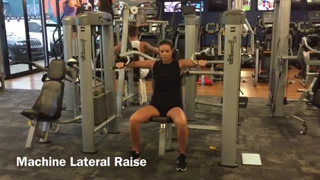 Female Machine Lateral Raise demonstration