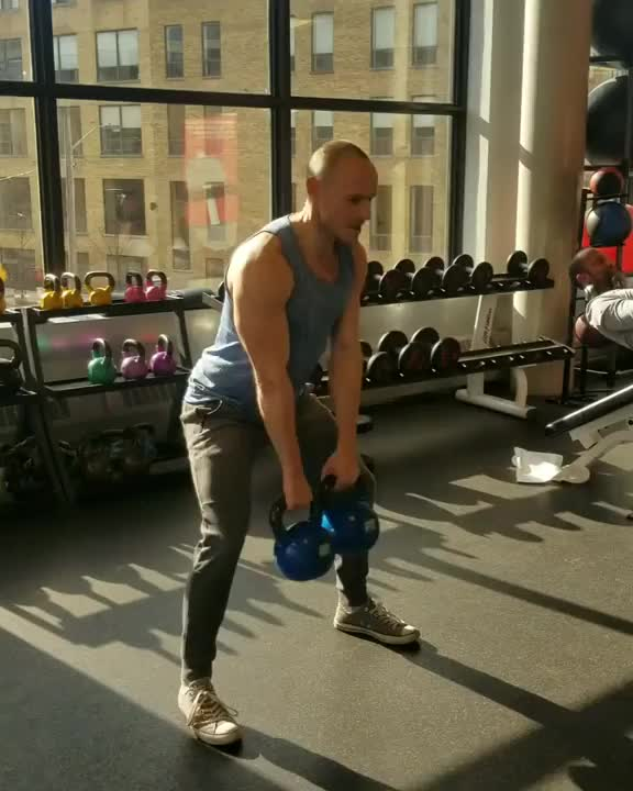 Double Kettlebell Clean to Reverse Lunge & Press demonstration